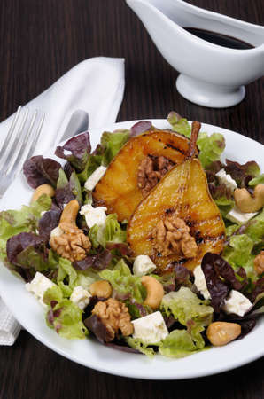 cellulose: Salad of lettuce with   walnuts, cashews, slices  feta,  halves of caramelized pear