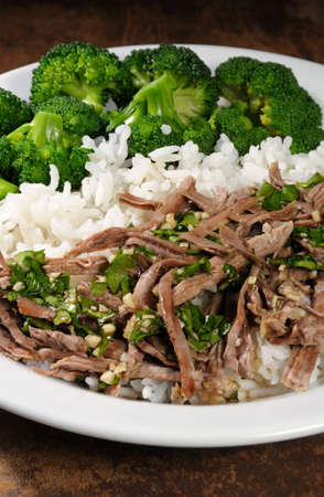 boiled beef with pungent spokes sauce garnish rice with broccoli