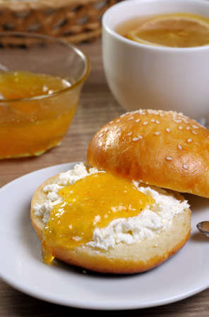 Cut bun with cottage cheese and orange jam