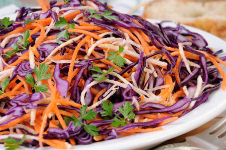 Coleslaw salad of red cabbage with carrots, Celery root