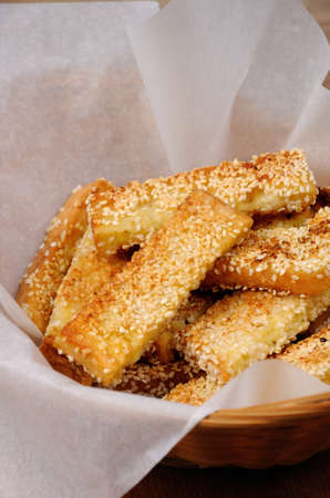 Slices of toast fried in breaded with cheese and sesame in a basket