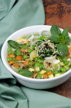 oneself: Light, refreshing soup of carrots, zucchini, potatoes, leeks, peas, pesto, parmesan and mint leaves.
