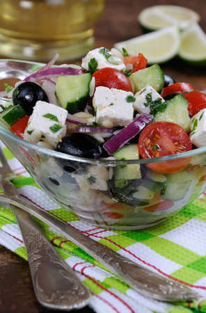 greek salad orzo pasta with black olive, red onion and cucumber, cherry tomatoes, feta and herbs