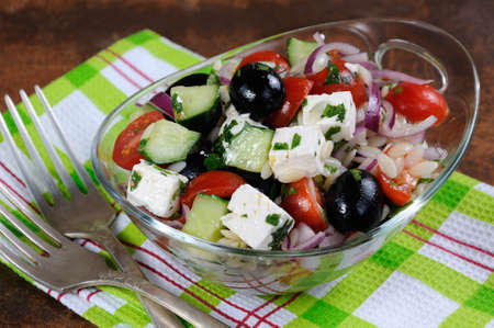 oneself: greek salad orzo pasta with black olive, red onion and cucumber, cherry tomatoes, feta and herbs