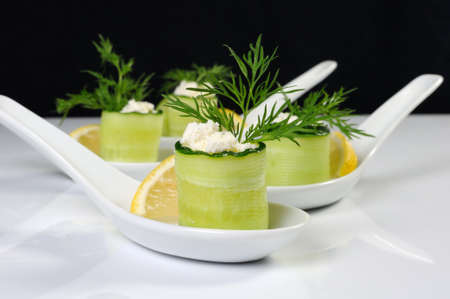 Cucumber canape with ricotta and lemon slice close-up. Horizontal shot. Foreground.