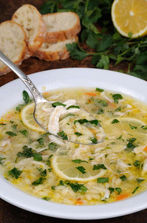 Avgolemono, greek   chicken soup with egg-lemon sauce, orzo and fresh parsley leaves