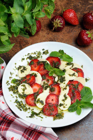 flavored: Light snack caprese with strawberries and mozzarella dressed   mint pesto