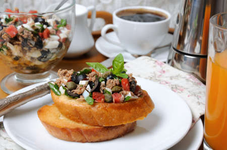 milkman: Breakfast from fried toast with chopped tuna with egg, cubes of tomatoes and olive slices, capers with a cup of coffee, a coffee pot on a tray