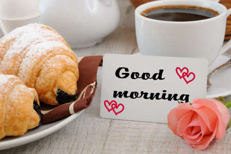 oneself: Breakfast of croissants   chocolate filling cup of fresh morning coffee and a card with a wish Good morning.