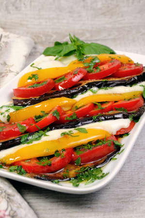 ration: Baked eggplants with tomatoes, yellow pepper and slices  mozzarella