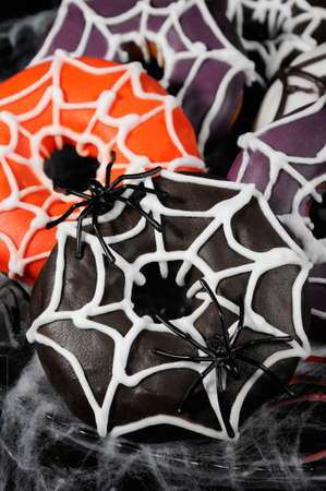 Glazed donuts decorated with cobwebs for Halloween