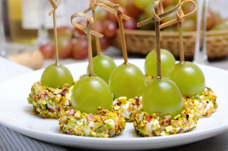 Canape  of cottage cheese cushions  in pistachios with grapes