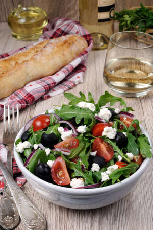 cellulose: Variation of Greek salad with arugula, cherry slices, feta and olives