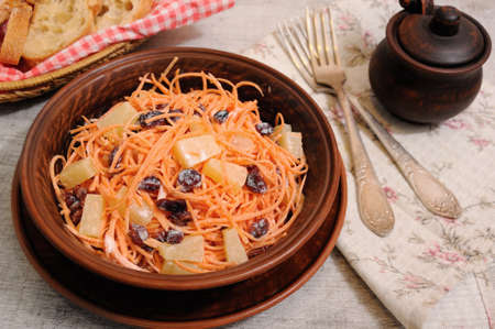 a salad of pineapple, fresh carrots, dried cranberries, yogurt dressed. Gluten free  vegan .