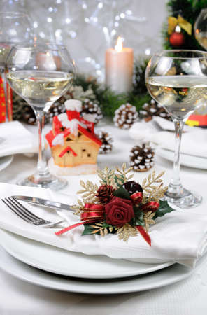Linen napkin, decorated with Christmas Corsage  on the table Stock Photo