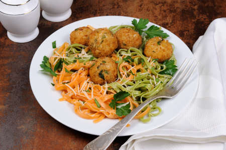 Spaghetti from carrots and spinach with chicken meatballs flavored cheese parmesan, herb