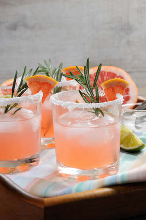 This magnificent cocktail of fresh pink Palomas.   A festive drink is ideal for brunch, parties and holidays. Stock Photo
