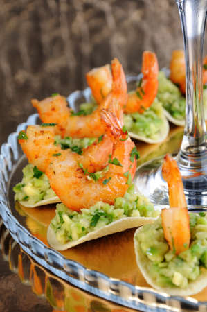 light snack of crisps with avocado filling and fried shrimp flavored with herbs.