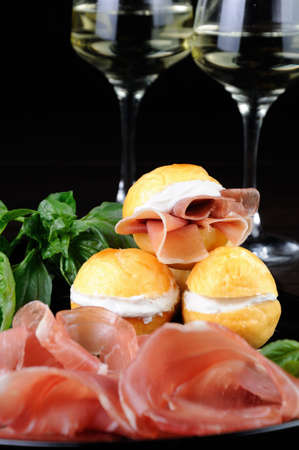 Coccoli is an appetizer from Italy. Pizza dough balls are fried and sprinkled with salt, served with prosciutto and cheese. Traditional Food During Christmas Period.They are also called pittule o pettole,I Coccoli toscani,Coccoli Fiorentini .