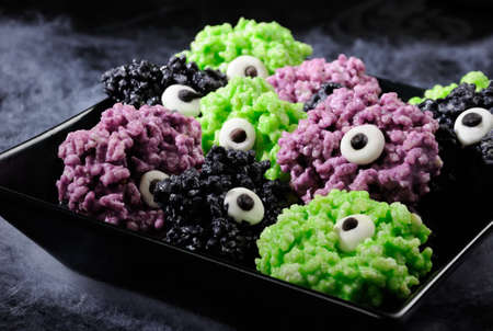 Monsters eye balls- made from marshmallows Rice krispies bites crispy bite balls. These are delicious, delight have a creepy monster and funny colors of Halloween