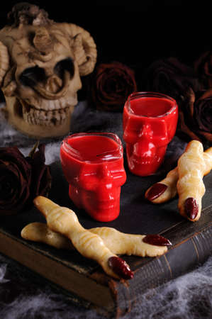 Dip crispy shortbread cookies in the form of witch fingers in hot chocolate Red Velvet.This is just delicious.