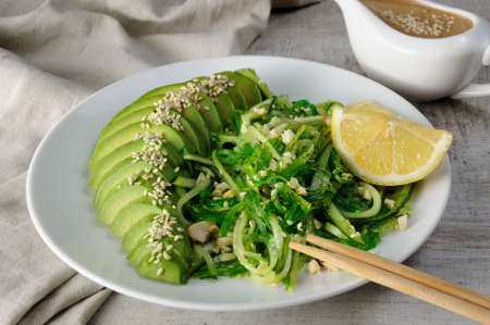 Chukka salad, cucumber noodles with avocado and peanut brown sauce in sauceboat
