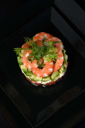 Tartare avocado   with mozzarella, tomatoes and shrimps.