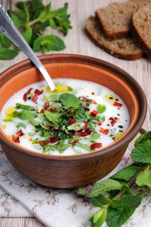 Refreshing сold summer soup the rice, mint and yoghurt, spices.