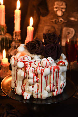 A  creepy cake (red velvet) decorated with meringue bones and drenched in blood. Great Halloween idea.