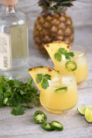 Tequila cocktail with pineapple juice, jalapeno  slices and cilantro, cooled with ice Zdjęcie Seryjne