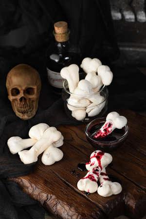 Creepy Meringue Bones, sweet treats for Halloween Фото со стока