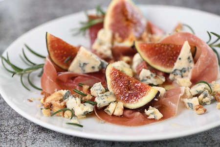 Figs with Parma ham with blue cheese, nuts and honey