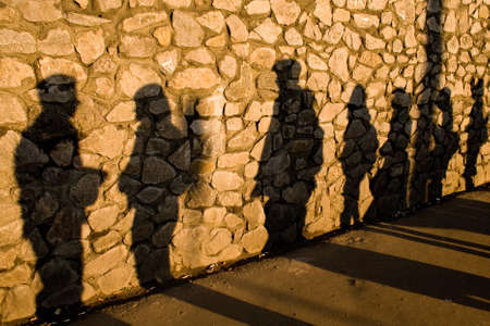 Shadows on the stone wall cast by random people Stock Photo - 7022343