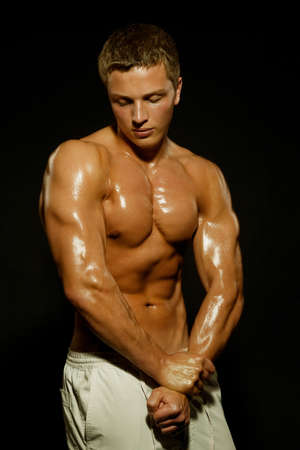 Young sports guy with a naked torso Stock Photo - 7081067