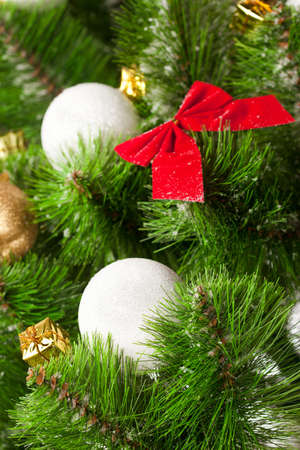 Green branches of a Christmas tree with toys photo