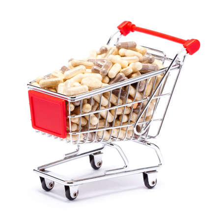 Carts on a white background filled with pills photo