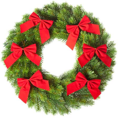 Green round Christmas wreath on white background
