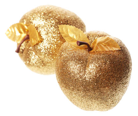 Golden apple lying on a white background photo