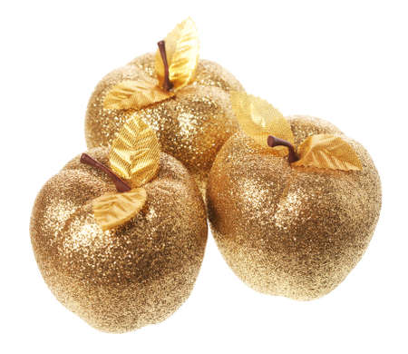 Golden apple lying on a white background