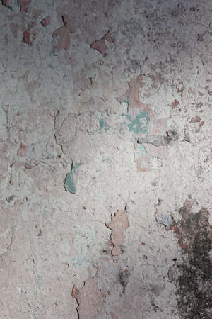 chipped: The old wall covered with plaster crashed