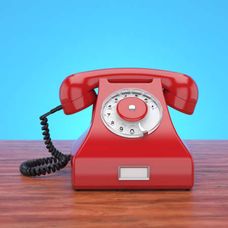 3D rendering old red phone on the table Stock Photo