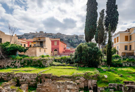 View of the Ancient Agora, in Athens, Greece. The historic district of Plaka and the Acropolis are in the background.