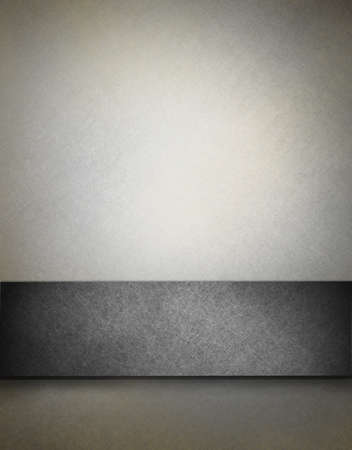 on gray: monochrome gray background with ribbon, grunge texture, and soft lighting Stock Photo