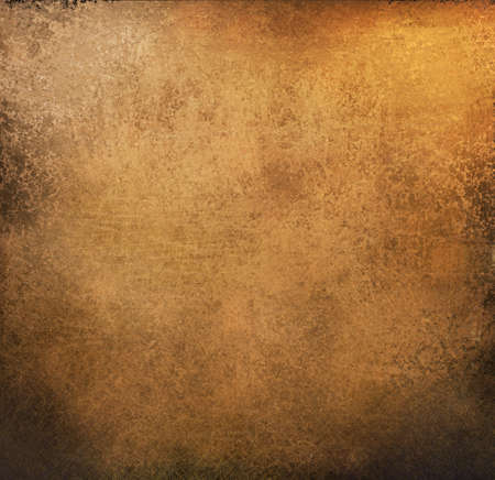 beautiful gold and brown background paper with vintage grunge scratches and texture with black scuffed edges and old faded antique design with copy space for ad brochure or announcement invitation Stock Photo - 12252747