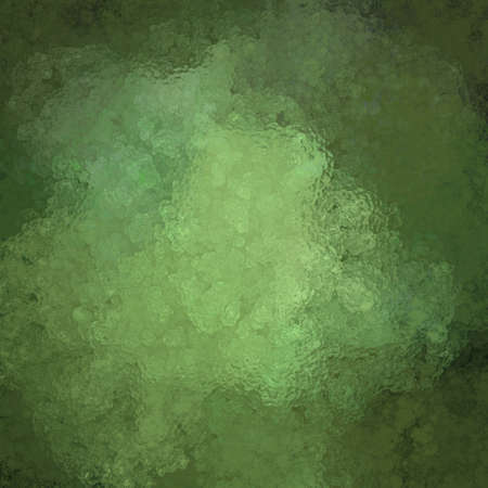 mottled green background with glassy vintage grunge texture and highlight with copy space for text or announcement for Christmas or St. Patrick Stock Photo