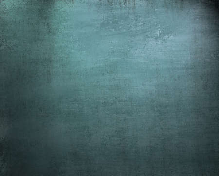 light blue background with vintage grunge texture and soft faded black vignette border on frame and copy space for text or ad or template photo
