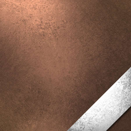 warm copper brown background or paper with elegant silver ribbon photo