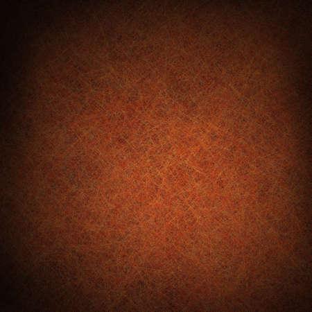 warm colors: color marr�n oscuro y fondo negro con textura grunge vintage y destacado centro blando de copyspace para el anuncio o un folleto