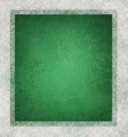 green background with white parchment frame on border with vintage grunge texture and faded soft lighting with copyspace  photo