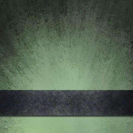abstract black and green background with vintage grunge texture smeared on paper with black edges and bright highlight under black ribbon stripe photo